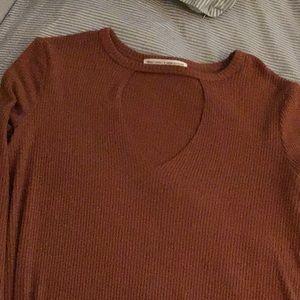 Long sleeve Burnt orange shirt w/ peep hole